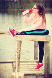 Woman with water bottle after exercising workout Royalty Free Stock Photography