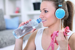 Woman with water bottle and measuring tape Royalty Free Stock Image