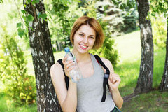 Woman with water bottle Royalty Free Stock Photography