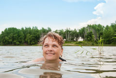 Woman in water. Close up of a woman's face swimming in the lake Royalty Free Stock Images