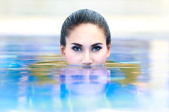 Woman in the water Stock Photos