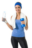 Woman with water and dumbbell Royalty Free Stock Images