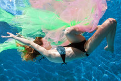Woman in water with fabric. Royalty Free Stock Photos