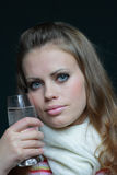 Woman with a water glass. Young brown-haired woman with a water glass Stock Photo