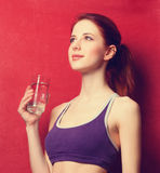 Woman  with water glass after weight loss Royalty Free Stock Photography