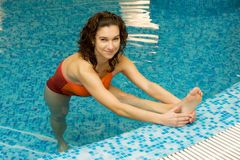 Woman in water gymnastics Royalty Free Stock Photography