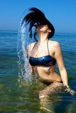 Woman in the water making waves with her hair Stock Photo