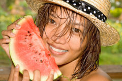 Woman with a water melon. Young woman holding a fresh water melon Royalty Free Stock Photo