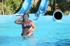 Woman in the water-park Stock Photo