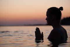 Woman in water during pray or meditation Royalty Free Stock Photo
