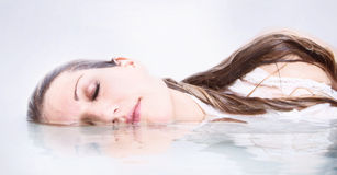 Woman in water with reflection Royalty Free Stock Photo
