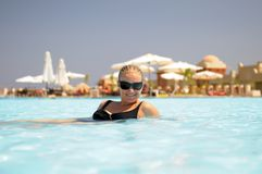 Woman in water at a resort Royalty Free Stock Images