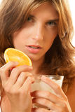 Woman with water and slice of orange Stock Photo