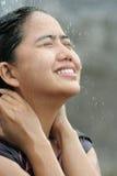 Woman in water splash. Portrait of woman in water splash feel fresh Royalty Free Stock Image