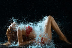 Woman And Water Splash In Dark Stock Image