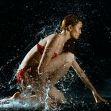 Woman And Water Splash In Dark Royalty Free Stock Photos