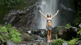 woman at waterfall stock video footage