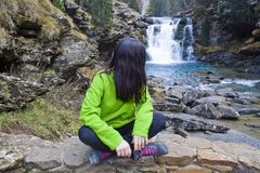 Woman in a waterfall. Woman sit in a waterfall in the mountains, Ordesa, Huesca, Spain Royalty Free Stock Image