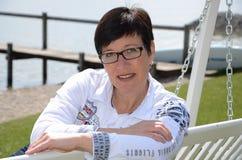 Woman at the waterfront at lake chiemsee Stock Photo