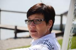 Woman at the waterfront at lake chiemsee Royalty Free Stock Photos