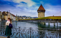 Woman on waterfront in Switzerland Stock Photography