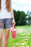 Woman with watering can Royalty Free Stock Photo