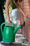 Woman with watering can Royalty Free Stock Photography