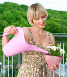Woman watering flower plant Royalty Free Stock Photos