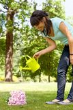 Woman watering flowers Stock Photos
