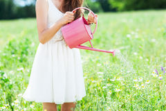 Woman watering flowers Stock Image