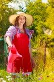 Woman watering flowers in garden Stock Photo