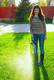 Woman is watering a garden Stock Photo