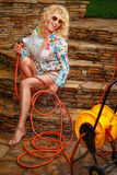 Woman watering with garden hose Royalty Free Stock Photo