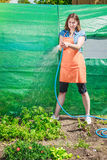 Woman watering the garden with hose Royalty Free Stock Photos
