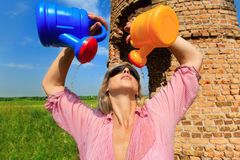 Woman watering herself Royalty Free Stock Photos