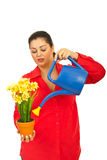 Woman watering plant Royalty Free Stock Photo
