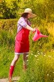 Woman watering plants in garden Stock Photos