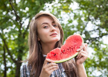 Woman and watermelon Stock Images