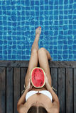 Woman with watermelon poolside Royalty Free Stock Photos