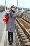 Woman wave goodbye Stock Image