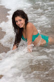 Woman in the waves Stock Photography