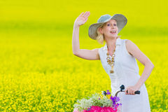 Woman waving Royalty Free Stock Photos