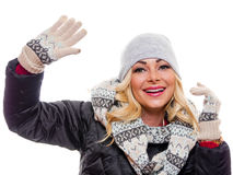 Woman waving. A attractive blond woman dressed for winter is waving stock images