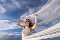 Woman and waving cloth Royalty Free Stock Photo
