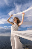 Woman and waving cloth Royalty Free Stock Photography