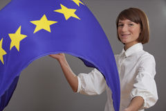 Woman waving european flag Stock Images