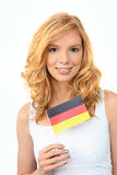 Woman waving a German flag Royalty Free Stock Photos