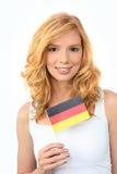 Woman waving a German flag. Pretty woman waving a German flag royalty free stock photos