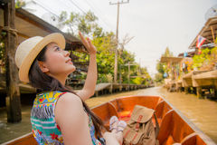 Woman waving goodbye at canal boat Stock Photos