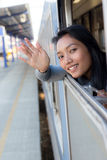 Woman waving a greeting from moving train Royalty Free Stock Photography